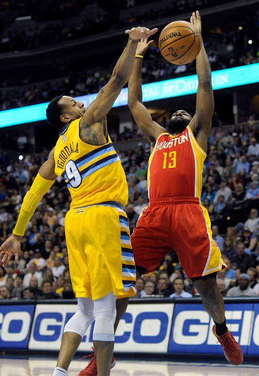 . DENVER, CO. - APRIL 6: Andre Iguodala (9) of the Denver Nuggets slapped the ball from James Harden (13) of the Houston Rockets in the first half. The Denver Nuggets hosted the Houston Rockets at the Pepsi Center Saturday night, April 6, 2013. Photo By Karl Gehring/The Denver Post)