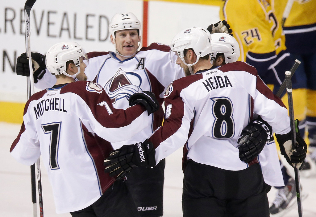 . Colorado Avalanche defenseman Jan Hejda (8), of the Czech Republic, celebrates with John Mitchell (7) and Cody McLeod (55) after Hejda scored against the Nashville Predators in the first period of an NHL hockey game, Saturday, Jan. 18, 2014, in Nashville, Tenn. (AP Photo/Mark Humphrey)