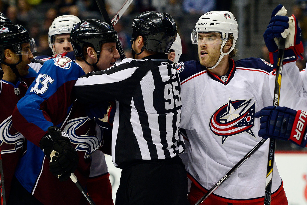 . Cody McLeod (55) of the Colorado Avalanche and David Savard (58) of the Columbus Blue Jackets mix it up near the Blue Jackets\' goal during the first period. The Colorado Avalanche hosted the Columbus Blue Jackets at the Pepsi Center on Tuesday, December 31, 2013. (Photo by AAron Ontiveroz/The Denver Post)