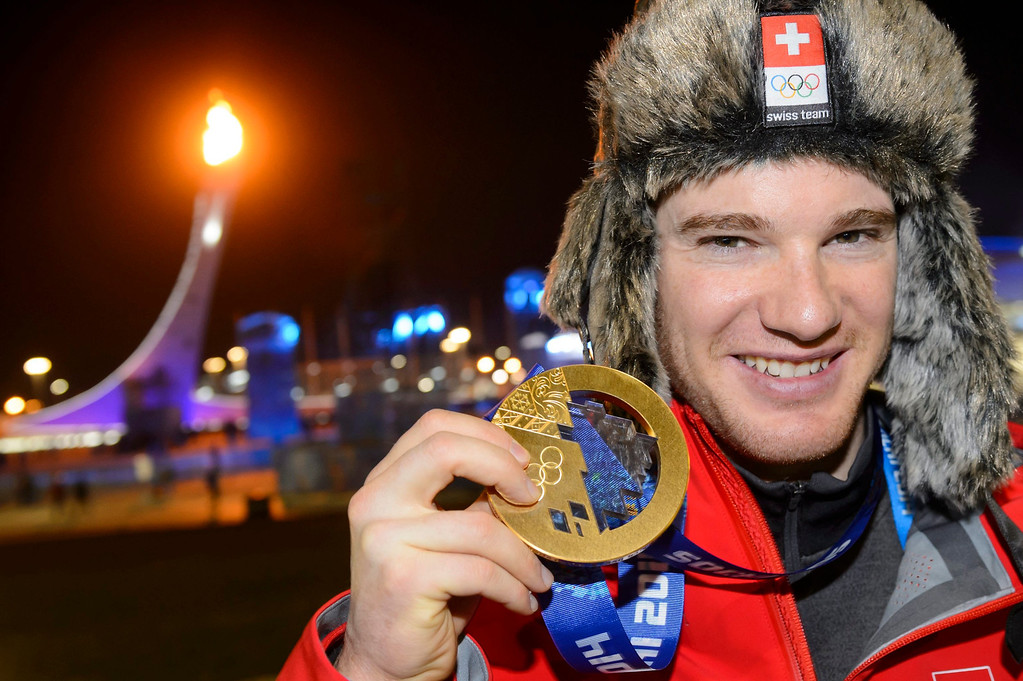 . Gold medalist Dario Cologna of Switzerland poses with his medal after the medal ceremony for the Men\'s 15km + 15km Skiathlon at the Sochi 2014 Olympic Games, Sochi, Russia, 09 February 2014.  EPA/LAURENT GILLIERON