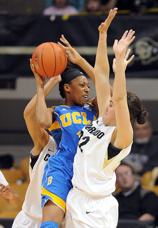 . UCLA\'s Atonye Nyingifa tries to pass around Colorado\'s Haley Smith during the first half of an NCAA college basketball game Friday, Feb. 28, 2014, in Boulder, Colo. (AP Photo/Daily Camera, Cliff Grassmick)