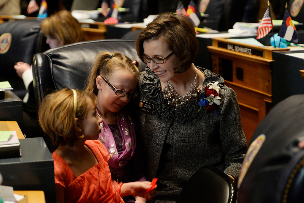 . DENVER, CO. - JANUARY 08: Senator Rachel Zenzinger sits with her daughters Sophia, 9, left,  and Olivia, 8, during the first day of the new legislative session at the Colorado Capitol in Denver, CO January 08, 2014. Zenzinger was appointed to fill the seat vacated by former Sen. Evie Hudak. (Photo By Craig F. Walker / The Denver Post)