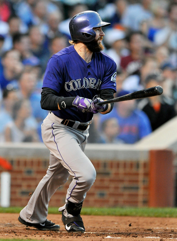 . Colorado Rockies\' Charlie Blackmon watches his RBI double during the second inning of a baseball game against the Chicago Cubs in Chicago, Wednesday, July 30, 2014. (AP Photo/Paul Beaty)