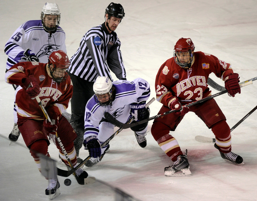 . DENVER, CO. - OCTOBER 25: Denver wing Trevor Moore (8) battled for the puck with Niagara wing Sam Alfieri (12) off a face off in the first period. The University of Denver hockey team hosted Niagara at Magness Arena Friday night, October 25, 2013. Photo By Karl Gehring/The Denver Post