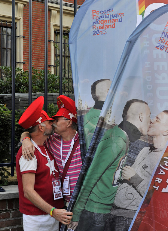 """. An homosexual couple kisses during  \'Kiss-In\' action by more than 300 gay and lesbian supporters participate in front of the Russian consulate in Antwerp to protest against the treatment of lesbian, gay, bisexual and transgender oriented people in Russia on August 9, 2013.  Russia on Friday said it was unperturbed by threats of an Olympic boycott over a controversial law banning \""""homosexual propaganda\"""", despite wide-ranging criticism of the legislation from athletes to US President Barack Obama. GEORGES GOBET/AFP/Getty Images"""
