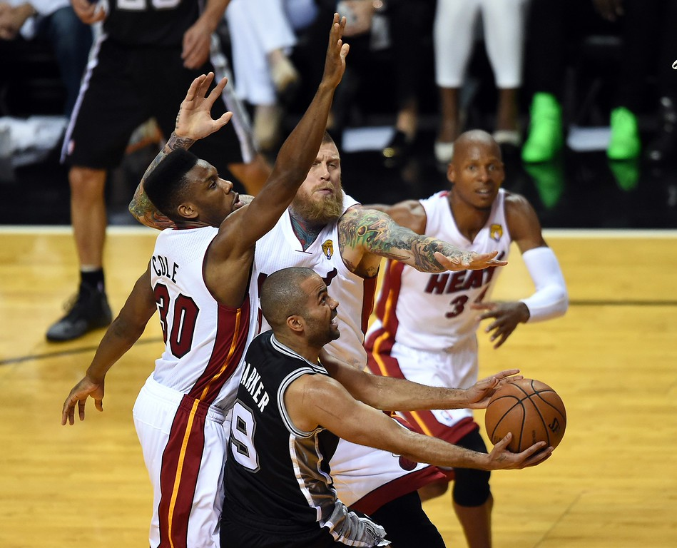 . Norris Cole of the Miami Heat (L) defends against Tony Parker (R) of the San Antonio Spurs during Game 4 of the 2014 NBA Finals on June 12, 2014  at the American Airlines Arena in Miami, Florida. TIMOTHY A. CLARY/AFP/Getty Images