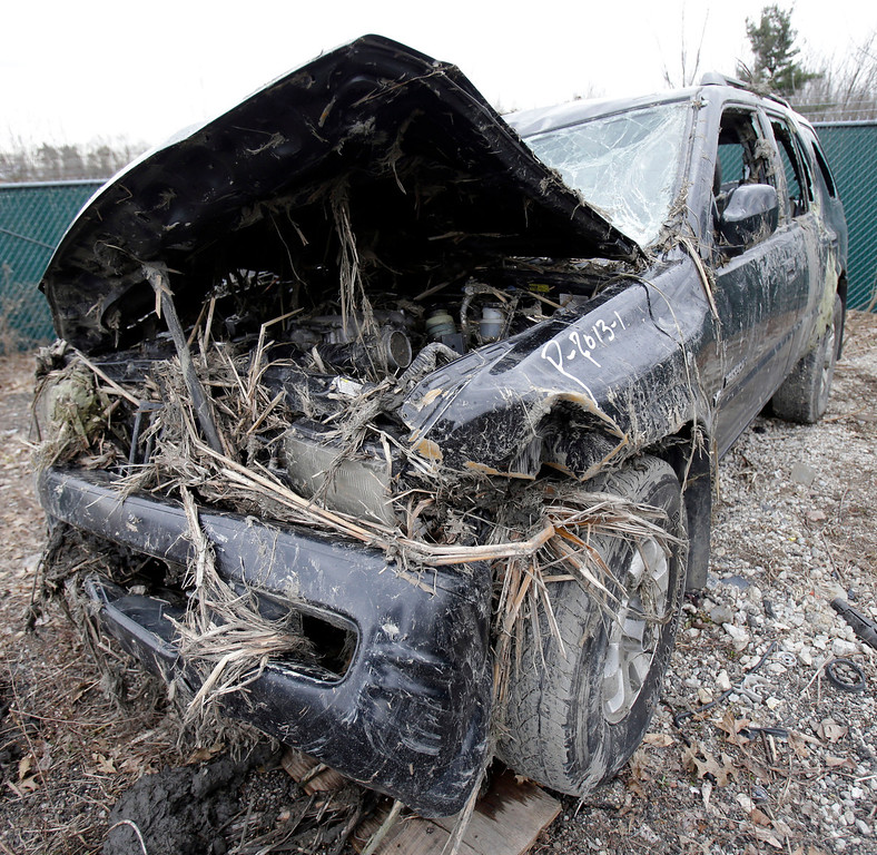 . This Monday, March 11, 2013 photo in Southington, Ohio shows the vehicle where six people died in a crash early Sunday in Warren, Ohio. (AP Photo/Tony Dejak)