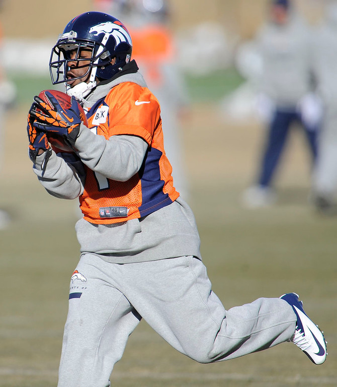 . Denver Broncos wide receiver Trindon Holliday (11) catches a pass during  practice Thursday, January 3, 2013 at Dove Valley.  John Leyba, The Denver Post