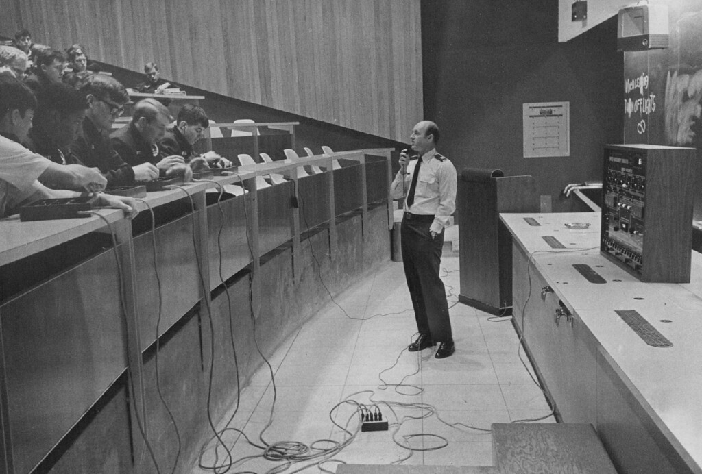 ". Captain Bill Nolls lectures his class on future energy development and use. He\'s an academy chemistry instructor and one of the developers of the ""doomsday machine.\"" 1977.  The Denver Post Library Archive"