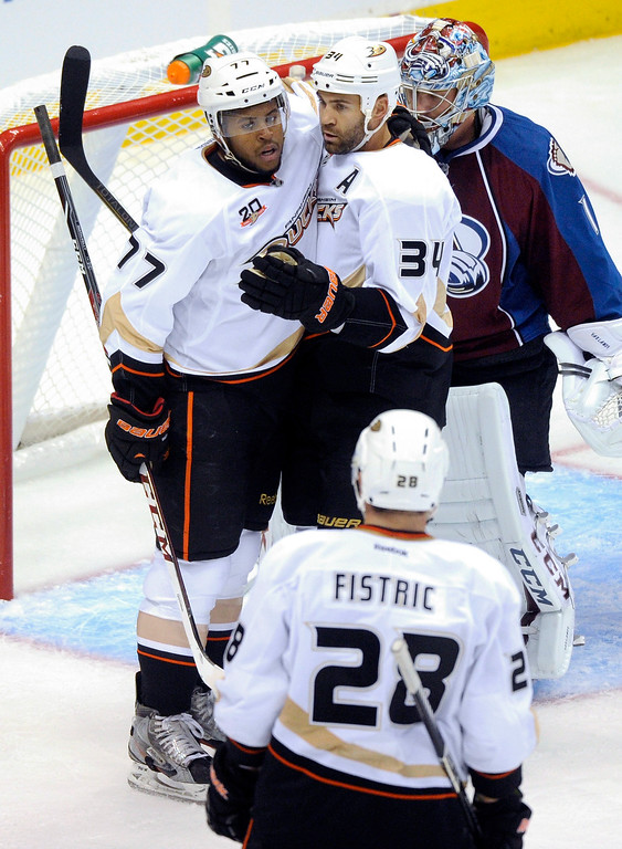 . Anaheim forward Daniel Winnik (34) congratulated teammate Devante Smith-Pelly (77) following his goal in the second period Wednesday night.  Photo By Karl Gehring/The Denver Post