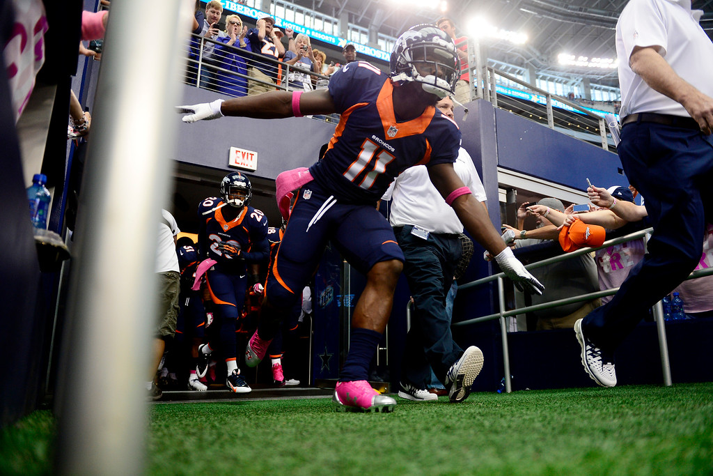 . Trindon Holliday (11) of the Denver Broncos leads the team onto the field before the first half of action at AT&T Stadium.   (Photo by AAron Ontiveroz/The Denver Post)