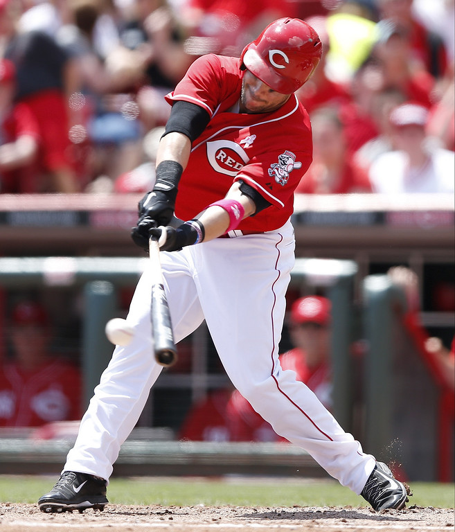 . Skip Schumaker #25 of the Cincinnati Reds singles to drive in a run in the third inning of the game against the Colorado Rockies at Great American Ball Park on May 11, 2014 in Cincinnati, Ohio. (Photo by Joe Robbins/Getty Images)