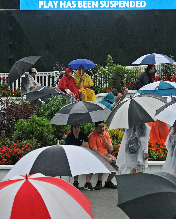 . A rain delayed part of the first round of the 113th US Open Golf Championship, at Merion Golf Club in Haverford.  Spectators try to stay drive beneath umbrellas in the merchandise square area. Photo by Tom Kelly IV Daily Local News