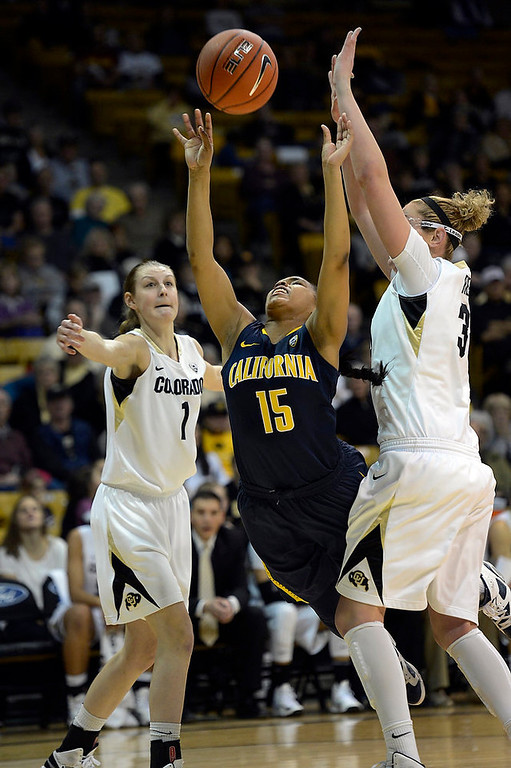 . California Golden Bears guard Brittany Boyd (15) tries to get off a hot past Colorado Buffaloes forward Jen Reese (34) during the first half Sunday, January 6, 2013 at Coors Events Center. John Leyba, The Denver Post