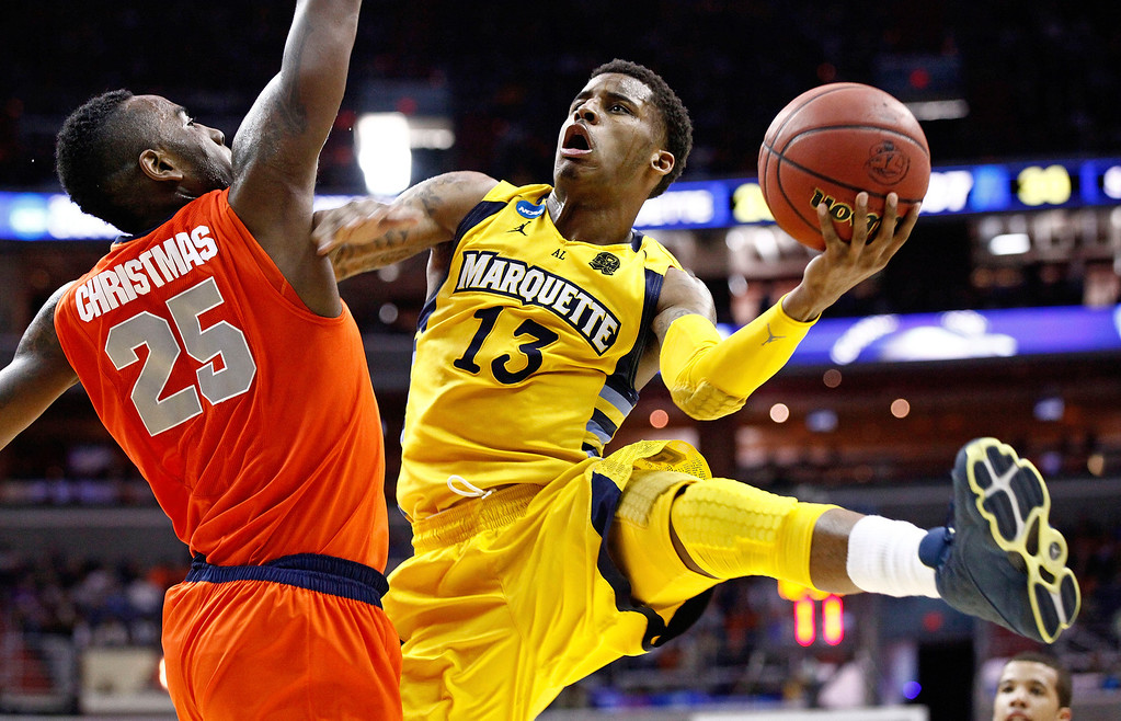 . Marquette guard Trent Lockett (13) shoots past Syracuse forward Rakeem Christmas (25) during the second half of the East Regional final in the NCAA men\'s college basketball tournament, Saturday, March 30, 2013, in Washington. (AP Photo/Mark Tenally)