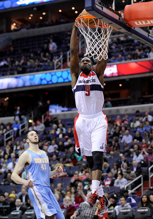 . Washington Wizards forward Martell Webster (9) dunks against Denver Nuggets center Kosta Koufos (41) during the second half of an NBA basketball game, Friday, Feb. 22, 2013, in Washington. The Wizards won 119-113. (AP Photo/Nick Wass)