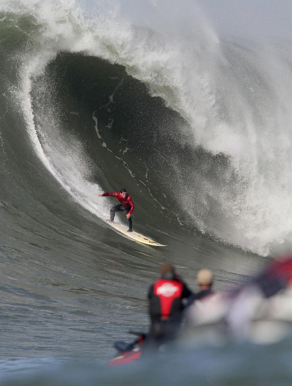 . FILE PHOTO--Dave Wassel, of Hawaii, rides a wave during the Mavericks Surf Contest in Princeton-by-the-Sea, Calif., on Saturday, Feb. 13, 2010. South African Chris Bertish beat 24 of the world\'s best big wave surfers in this contest held approximately a half mile offshore.  Many waves were as much as 40-50 feet. (Jane Tyska/Staff)