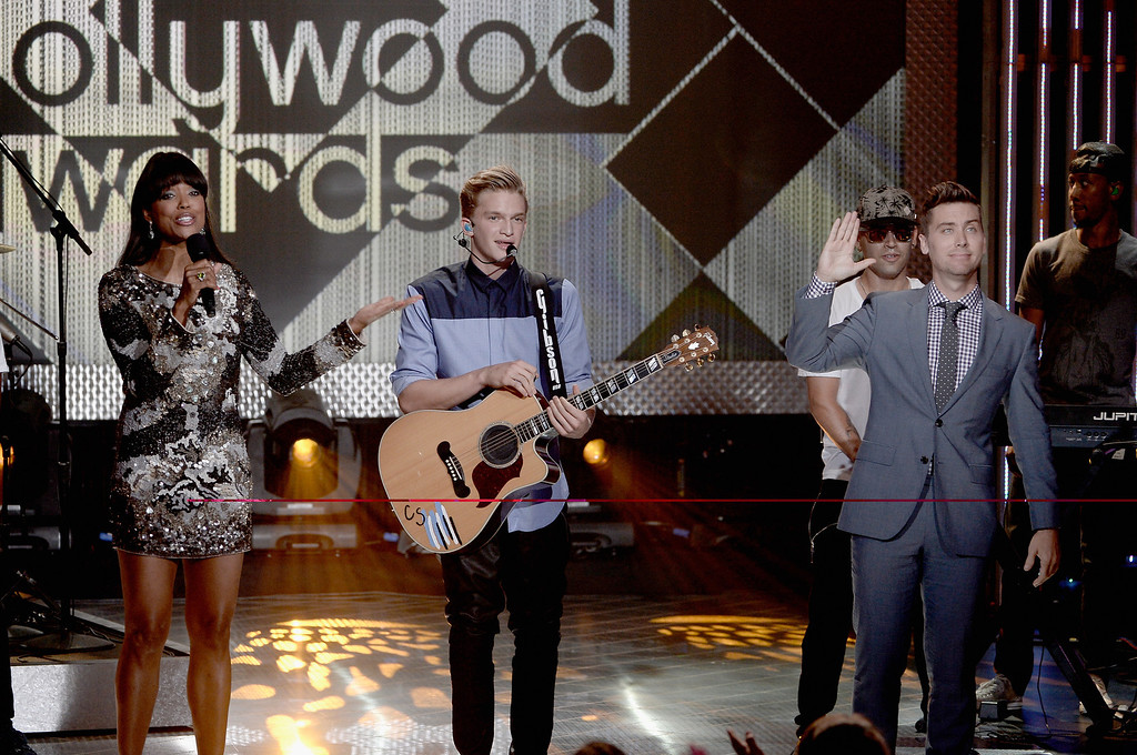. (L-R) Host Aisha Tyler, musician Cody Simpson, and host Lance Bass perform on stage during the CW Network\'s 2013 Young Hollywood Awards presented by Crest 3D White and SodaStream held at The Broad Stage on August 1, 2013 in Santa Monica, California.  (Photo by Kevin Winter/Getty Images for PMC)