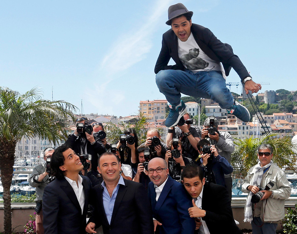 ". Cast member Jamel Debbouze (top) jumps as cast member Tewfik Jallab (L), director Mohamed Hamidi (2ndL), cast members Fatsah Bouyahmed (2ndR) and Malik Bentalha (R) pose during a photocall for the film ""Ne quelque part\"" at the 66th Cannes Film Festival in Cannes May 21, 2013.               REUTERS/Jean-Paul Pelissier"