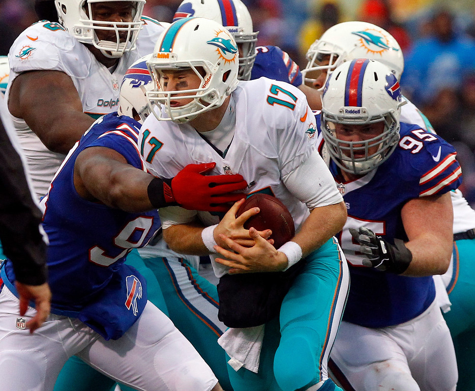 . Miami Dolphins quarterback Ryan Tannehill (17) is sacked by Buffalo Bills defensive end Mario Williams (94) and defensive tackle Kyle Williams (95) during the first half of an NFL football game on Sunday, Dec. 22, 2013, in Orchard Park, N.Y. Buffalo won 19-0. (AP Photo/Bill Wippert)