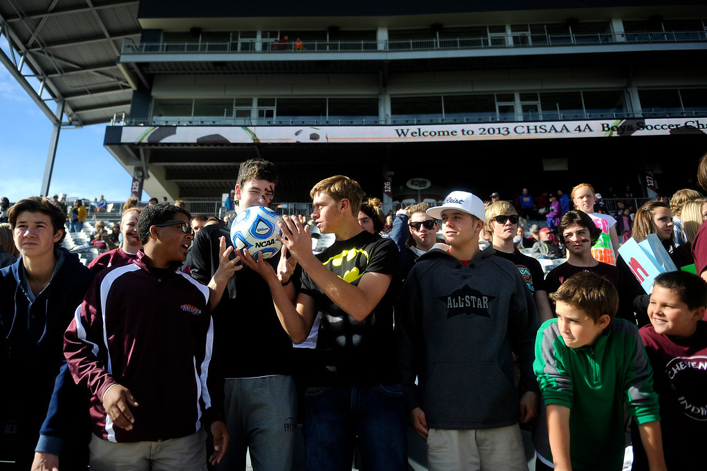 . DENVER CO: Nov. 9, 2013  Cheyenne Mountain fans pass around and kiss the game ball before the second half began. Cheyenne Mountain defeated Air Academy 2-1 in the 4A State Championship at Dick\'s Sporting Goods Park on Nov. 9, 2013.   (Photo By Erin Hull/The Denver Post)