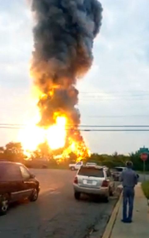 . This still taken from video provided by James LeBrun shows an explosion outside Baltimore on Tuesday, May, 28, 2013. Baltimore County fire officials say a train derailed in a Baltimore suburb on Tuesday and an explosion was heard in the area. (AP Photo/James LeBrun)