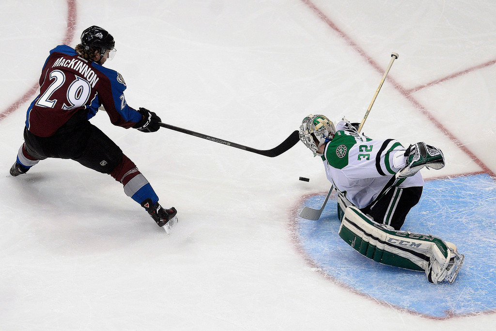 . Dallas Stars goalie Kari Lehtonen (32) stops a shot by Colorado Avalanche center Nathan MacKinnon (29) during the second period of action. (Photo by AAron Ontiveroz/The Denver Post)