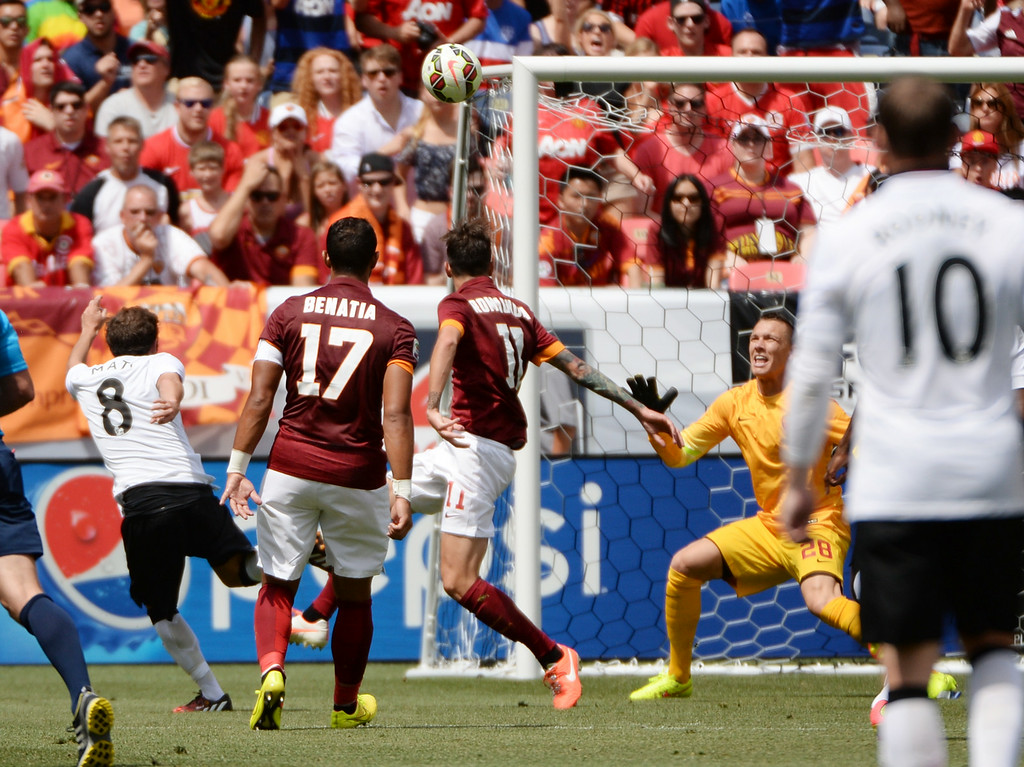 . Juan Mata of Manchester United (8), left, scores a goal in the 1st half of the game against AS Roma in Guinness International Champions Cup 2014 at Sports Authority Field at Mile High. Denver, Colorado. July 26. 2014. (Photo by Hyoung Chang/The Denver Post)