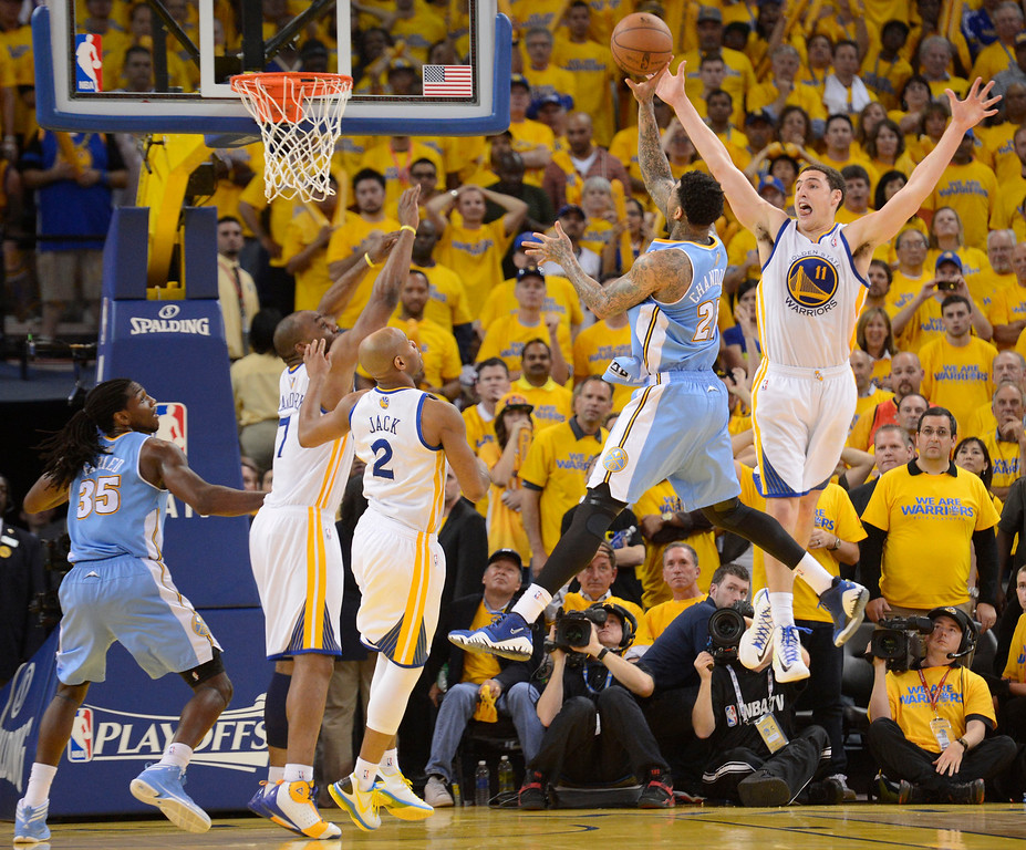. Wilson Chandler (21) of the Denver Nuggets takes a shot with 00:12.9over Klay Thompson (11) of the Golden State Warriors and missed in Game 6 of the first round NBA Playoffs May 2, 2013 at Oracle Arena. (Photo By John Leyba/The Denver Post)