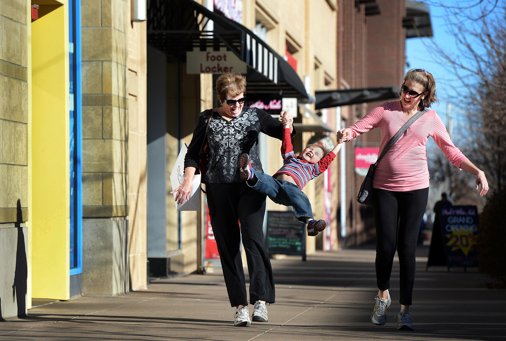 """. Beth Melninkaitis, right, and her son Caleb, 4, enjoy shopping with Melninkaitis\' mother, LeAnna Mosher, at Belmar in Lakewood, CO, January 22, 2013. Mosher said she likes living close by, \""""it\'s fun to get out and walk. They have a great farmers market in the summer.\"""" (Photo By Craig F. Walker / The Denver Post)"""