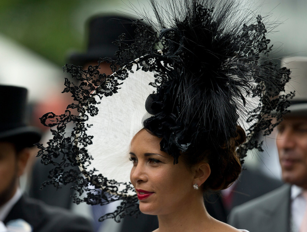 . Princess Haya of Jordan wears an ornate hat in the parade ring on the third day of the Royal Ascot horse racing meeting, which is traditionally known as Ladies Day, at Ascot, England,  Thursday, June, 19, 2014.  Royal Ascot the annual five day horse race meeting that Britain\'s Queen Elizabeth II attends every day of the event. (AP Photo/Alastair Grant)