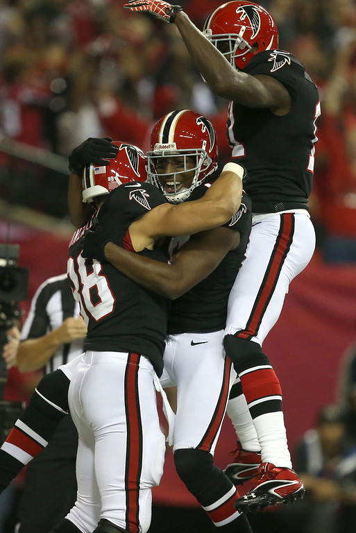 . Atlanta Falcons tight end Tony Gonzalez, left, celebrates his 17-yard touchdown catch with teammates Roddy White and Julio Jones, right, in the first half against the New Orleans Saints at the Georgia Dome in Atlanta, Georgia, on Thursday, November 29, 2012. (Jason Getz/Atlanta Journal-Constitution/MCT)