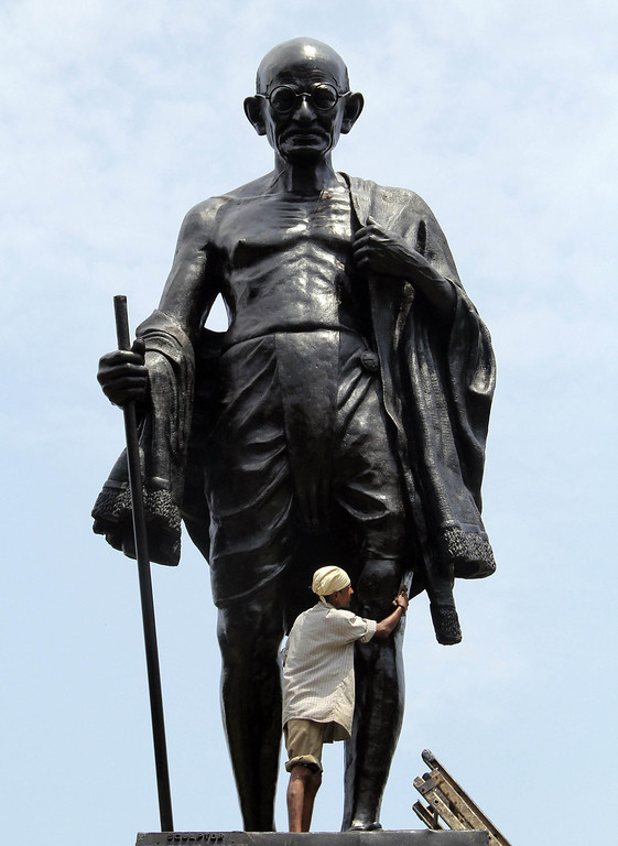 . An Indian civic worker cleans a statue of Mahatma Gandhi in Mumbai on September 30, 2012 ahead of Gandhi\'s 144th birth anniversary. Indians all over the country celebrate Gandhi\'s birthday with prayers and various social activities as a mark of respect to Gandhi, famed as the torchbearer of India\'s fight against British rule.  INDRANIL MUKHERJEE/AFP/Getty Images