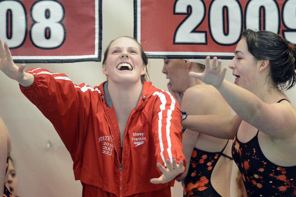 . Olympic gold medalist Missy Franklin of Regis Jesuit, left, and her teammate Reilly Hilbert dance during the swimming meet against Highlands Ranch at Regis Jesuit swimming pool on Tuesday. Aurora. CO, January 8, 2013.  Hyoung Chang, The Denver Post