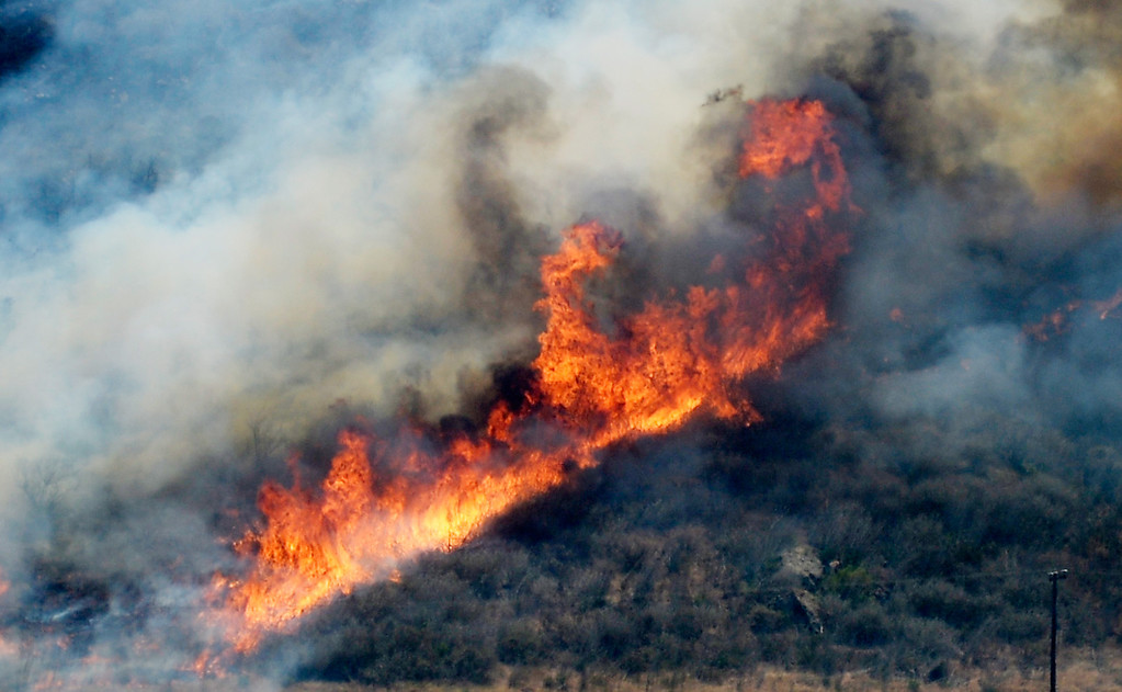 . An out of control wildfire burns in the hillside near an agricultural farm on May 2, 2013 in Camarillo, California.  (Photo by Kevork Djansezian/Getty Images)