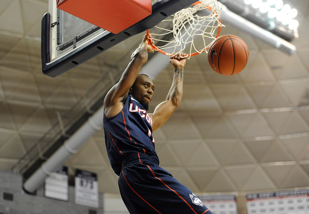 . Connecticut\'s Ryan Boatright dunks during a scrimmage at the men\'s and women\'s basketball teams\' First Night event Friday, Oct. 18, 2013, in Storrs, Conn. (AP Photo/Jessica Hill)