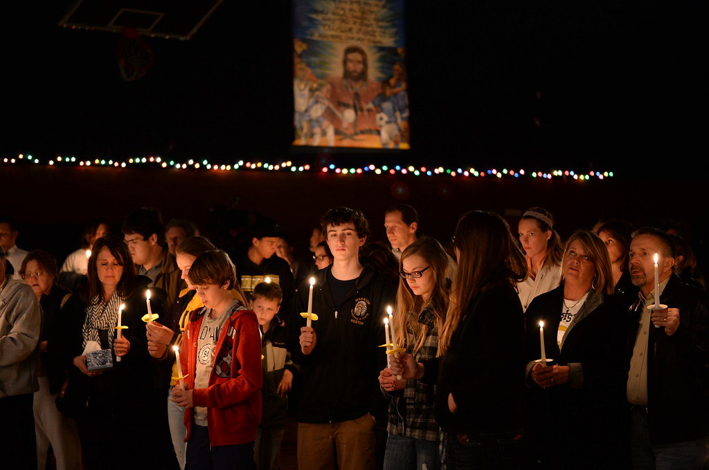 . CENTENNIAL, CO. - DECEMBER 20:  About a hundred people gathered for a candlelight vigil for Claire Davis inside Shepherd of the Hills Lutheran Church Friday night, December 20, 2013. Photo By Karl Gehring/The Denver Post
