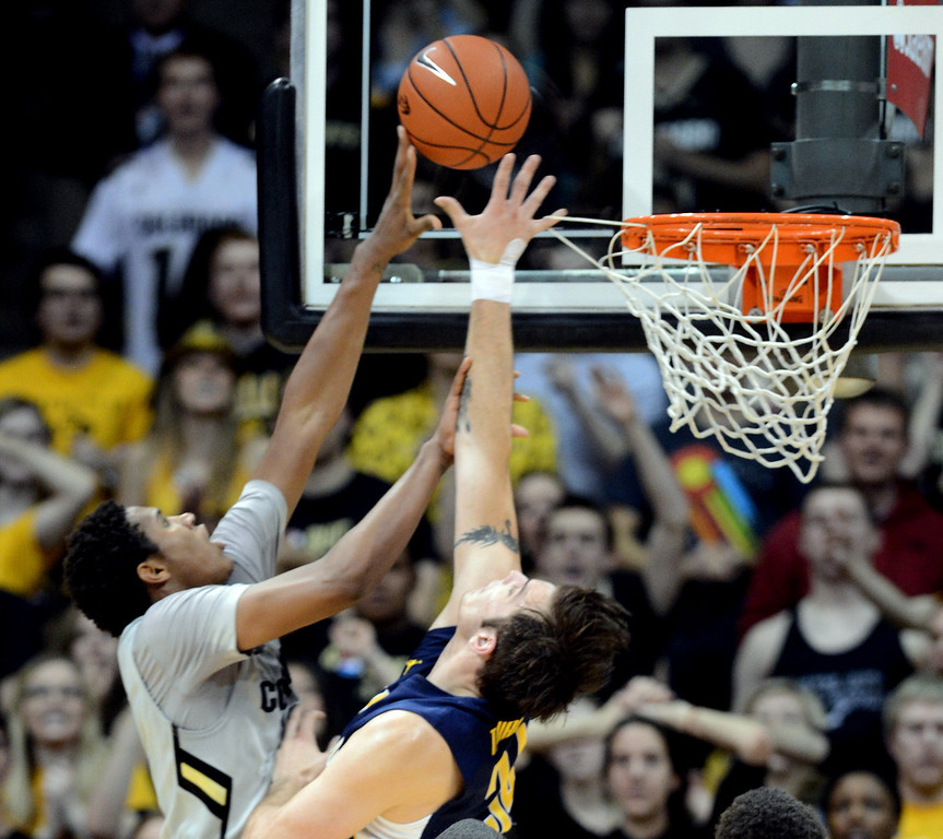 . Xavier Johnson of CU goes to the basket on Robert Thurman of Cal during the first half of the January 27th, 2013 game in Boulder. Cliff Grassmick/The Daily Camera