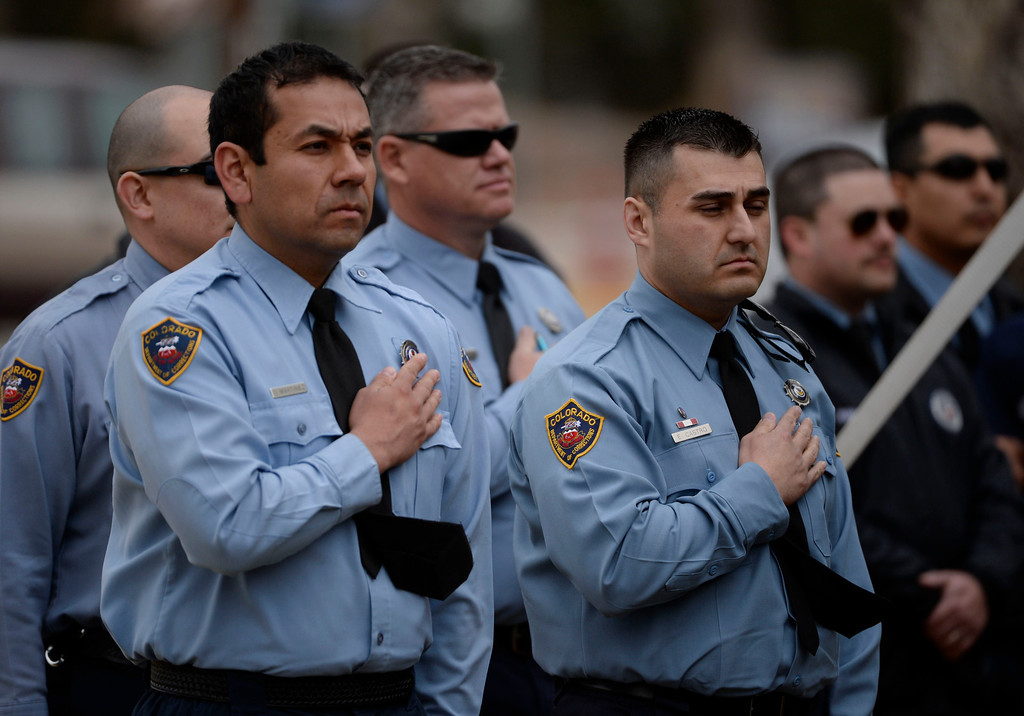 . Colorado Department of Corrections officers during the Pledge of Allegiance at the Fallen Officer Memorial honoring the head of the DOC, Tom Clements at the Territorial Correctional Facility park Saturday morning, March 15, 2014.  (Photo By Andy Cross / The Denver Post)