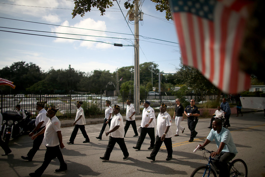 . Military veterans march in a Veterans Day ceremony on November 11, 2013 in Coconut Grove, Florida. The ceremony was held by the Coconut Grove American Legion Post #182 in honor of those veterans who have served the United States.  (Photo by Joe Raedle/Getty Images)