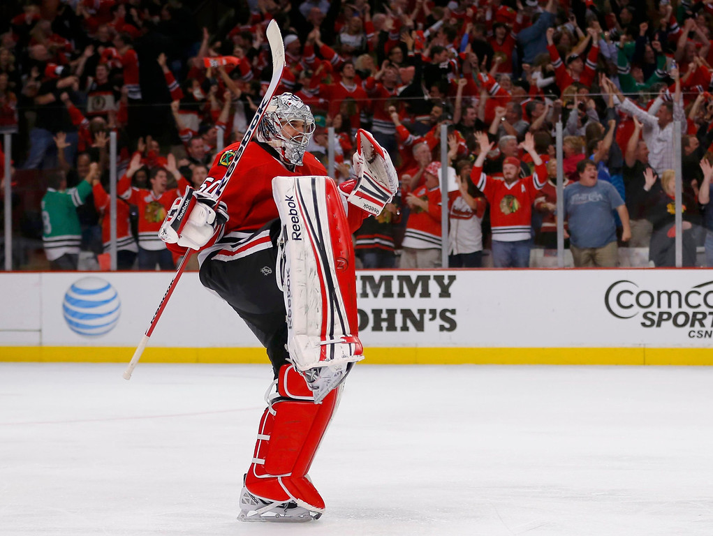 . Chicago Blackhawks goalie Corey Crawford celebrates after the Blackhawks defeated the Los Angeles Kings in Game 5 of their NHL Western Conference final hockey playoff series in Chicago, Illinois, June 8, 2013.  REUTERS/Jeff Haynes