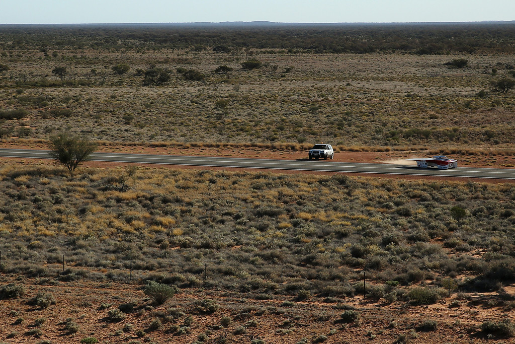 . ALICE SPRINGS, AUSTRALIA - OCTOBER 09:  Arrow1 from Team Arrow, Associated with Queensland University of Technology in Australia pulls out from their overnight camping spot to begin racing on Day 4 on October 9, 2013 between Alice Springs and Kulgera, Australia. Over 25 teams from across the globe are competing in the 2013 World Solar Challenge - a 3000 km solar-powered vehicle race between Darwin and Adelaide. The race began on October 6th with the first car expected to cross the finish line on October 10th.  (Photo by Mark Kolbe/Getty Images)