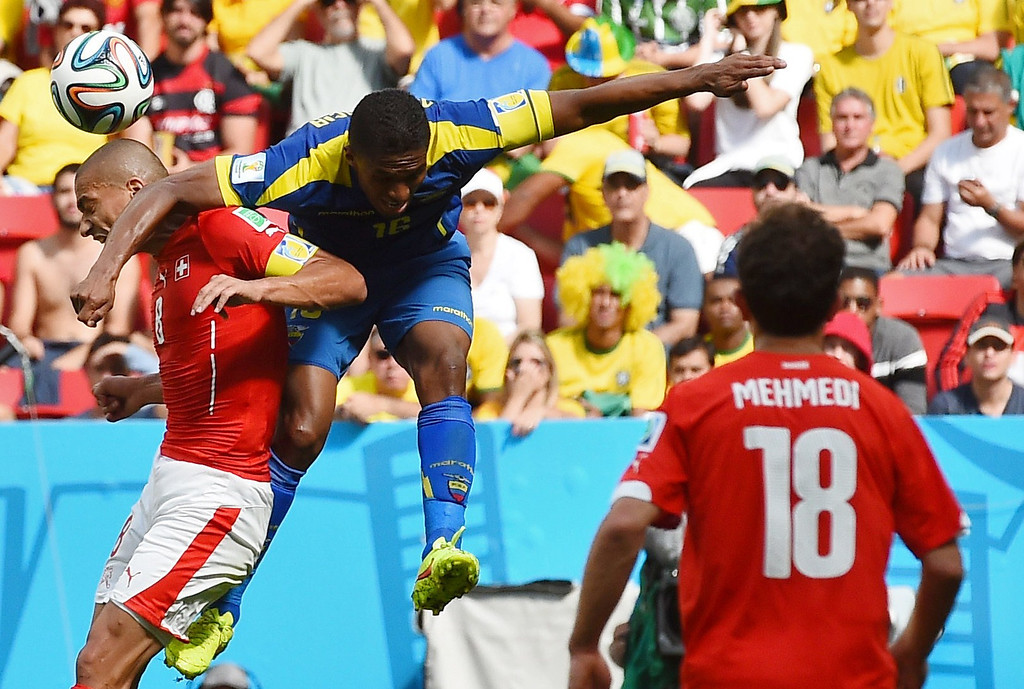 . Switzerland\'s midfielder and captain Goekhan Inler (L) vies with Ecuador\'s midfielder and captain Antonio Valencia during a Group E football match between Switzerland and Ecuador at the Mane Garrincha National Stadium in Brasilia during the 2014 FIFA World Cup on June 15, 2014.    AFP PHOTO/ ANNE-CHRISTINE POUJOULAT