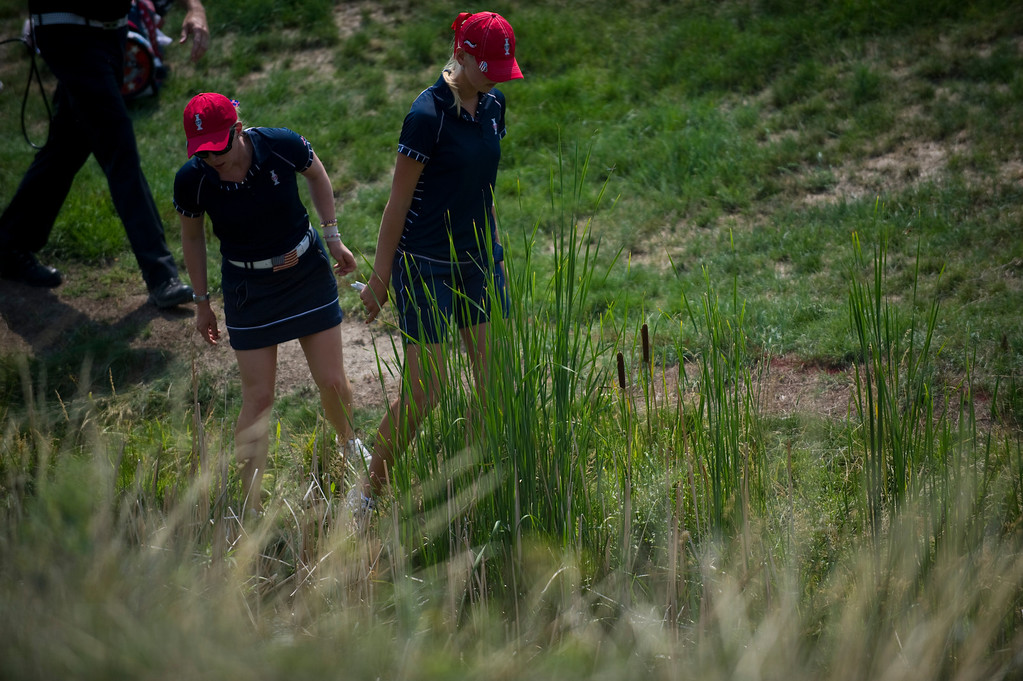 . PARKER, CO - AUGUST 16: Americans Jessica Korda, right, and Morgan Pressel look for a ball Korda hit into a hazard on the hole sixteen during the first day of the Solheim Cup at Colorado Golf Club, on August 16, 2013.  (Photo By Grant Hindsley/The Denver Post)