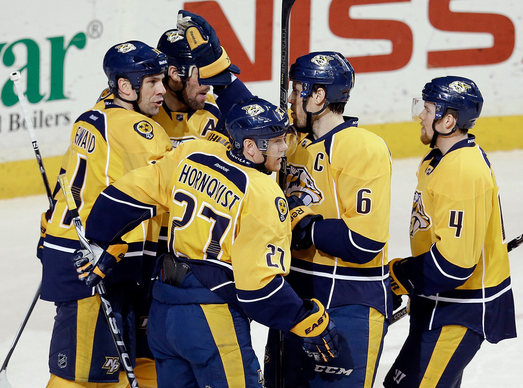 . Nashville Predators forward Patric Hornqvist (27), of Sweden, celebrates with David Legwand (11), Shea Weber (6) and Ryan Ellis (4) after Hornqvist scored against the Colorado Avalanche in the second period of an NHL hockey game Saturday, Jan. 18, 2014, in Nashville, Tenn. (AP Photo/Mark Humphrey)