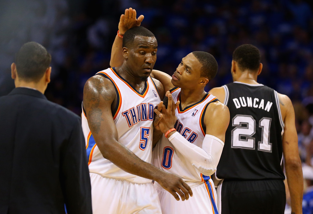 . OKLAHOMA CITY, OK - MAY 27:  Kendrick Perkins #5 and Russell Westbrook #0 of the Oklahoma City Thunder react after a play in the second quarter against the San Antonio Spurs during Game Four of the Western Conference Finals of the 2014 NBA Playoffs at Chesapeake Energy Arena on May 27, 2014 in Oklahoma City, Oklahoma. (Photo by Ronald Martinez/Getty Images)