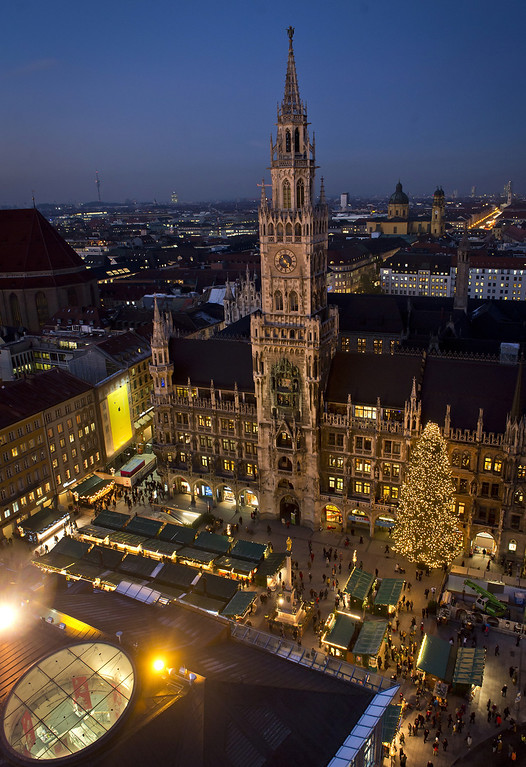 . People are enjoying the colourful stalls and the glittering lights at the Munich Christmas Market on Marienplatz at November 27, 2013 in Munich, Germany.  (Photo by Joerg Koch/Getty Images)
