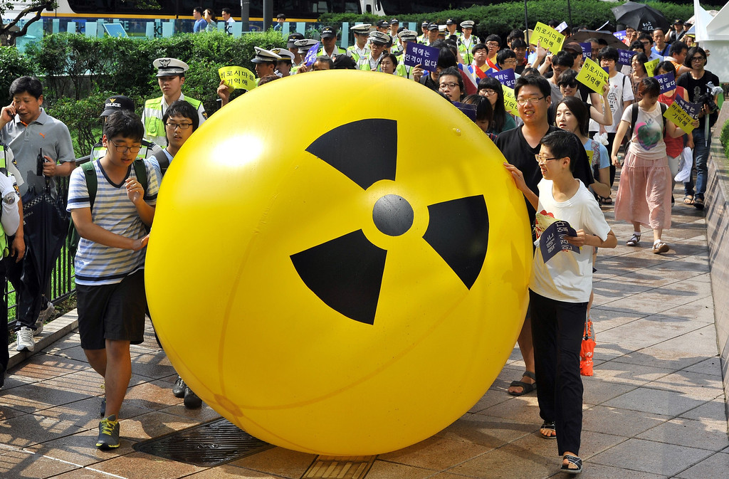 . South Korean activists march while rolling a large balloon with a radioactivity warning sign during an anti-nuclear protest in Seoul on August 6, 2013 on the 68th anniversary of the atomic bombing of Hiroshima in Japan. AFP PHOTO / JUNG YEON-JEJUNG YEON-JE/AFP/Getty Images