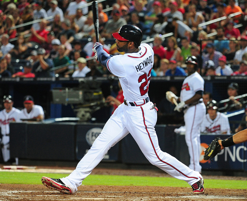 . Jason Heyward #22 of the Atlanta Braves hits a fourth inning two run home run against the Colorado Rockies at Turner Field on August 1, 2013 in Atlanta, Georgia. (Photo by Scott Cunningham/Getty Images)