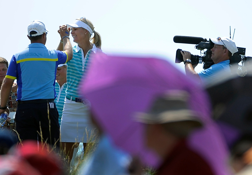 . PARKER, CO - Aug.17: Team Europe\'s Anna Nordqvist celebrates her hole-in-one on the 17th hole. The 2013 Solheim Cup takes place at the Colorado Golf Club with the USA taking on Europe in the Saturday morning Foursomes Match. (Photo By Kathryn Scott Osler/The Denver Post)